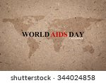 Small photo of World Aids Day on rough brown paper board backdrop with map for World Aids Day 1 December concept.