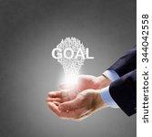 businessman holding in hands... | Shutterstock . vector #344042558