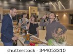 Small photo of KIEV, UKRAINE - NOVEMBER 21, 2015: Unrecognized young visitors taste samples of Single Malt Scotch Whisky at 1st Ukrainian Whisky Dram Festival in Parkovy Exhibition Center.