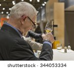Small photo of KIEV, UKRAINE - NOVEMBER 21, 2015: Unrecognized senior visitor taste sample of Single Malt Scotch Whisky at 1st Ukrainian Whisky Dram Festival in Parkovy Exhibition Center.