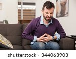 guy with a beard feeling unwell ... | Shutterstock . vector #344063903