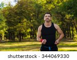 a man jogging in the park in... | Shutterstock . vector #344069330