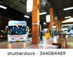 Blurry Image Of Bus Station At...