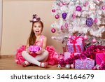 Girl Delighted With Gift. Chil...