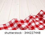 red tablecloth on wooden boards ...   Shutterstock . vector #344227448
