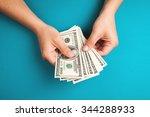 Man Counting Money  Economy...