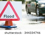 Warning Traffic Sign On Floode...