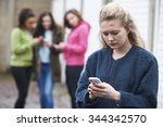 teenage girl being bullied by... | Shutterstock . vector #344342570