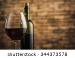 wine glass and bottle on a... | Shutterstock . vector #344373578