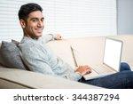 Handsome Man Using Laptop On...