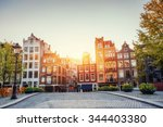 Stock photo amsterdam canal at sunset amsterdam is the capital and most populous city in netherlands 344403380