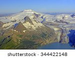 Small photo of Aerial View of Fourpeaked Mountain and Glacier on the Alaska Peninsula