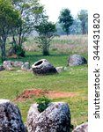 Small photo of Plain of jars in Laos,The Grave or Shrines,history of ancient grave or shrines,Once is air raid shelter in Indochina war.
