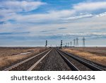 Twin Tracks and Blue Skies in Canadian Prairie - stock photo