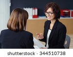 cheerful female manager talking ... | Shutterstock . vector #344510738