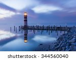a lighthouse reflected in a... | Shutterstock . vector #344560040