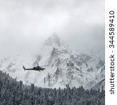 """Small photo of Russian Combat helicopter Mi-28 """"Havoc"""" over the winter mountains"""