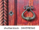 old wooden red door  with aged... | Shutterstock . vector #344598560