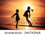 happy girls jumping on the... | Shutterstock . vector #344742968