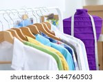 clothes hang on a shelf in ... | Shutterstock . vector #344760503