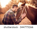 Young man hugs a horse. autumn...