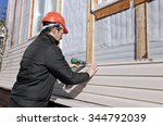 A Worker Installs Panels Beige...