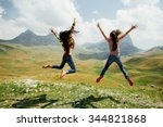 two long hair girls happy jump... | Shutterstock . vector #344821868