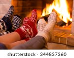 feet in wool socks near... | Shutterstock . vector #344837360