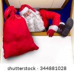 Santa Claus Carrying A Bag Of...