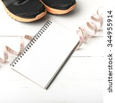 running shoes with notebook and ... | Shutterstock . vector #344955914