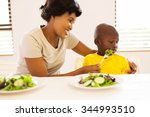 pretty african mother trying to ... | Shutterstock . vector #344993510