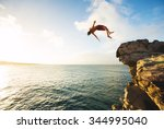 cliff jumping into the ocean at ... | Shutterstock . vector #344995040