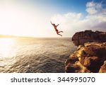 cliff jumping into the ocean at ...