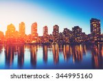 view of city skyline at sunset | Shutterstock . vector #344995160