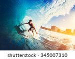 surfer on blue ocean wave... | Shutterstock . vector #345007310