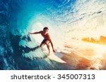 Surfer on Blue Ocean Wave Getting Barreled at Sunrise