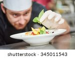 male cook chef decorating... | Shutterstock . vector #345011543