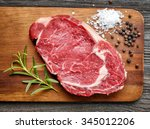 raw beef steak on wooden... | Shutterstock . vector #345012206