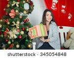 the girl opens a gift | Shutterstock . vector #345054848