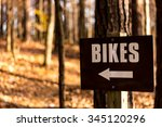 Bike Trail And Sign In The Woods
