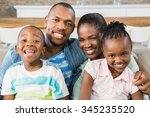 happy family relaxing on the... | Shutterstock . vector #345235520
