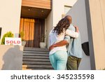 back view of couple with arms... | Shutterstock . vector #345235598