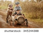Two Young Children Ride In The...