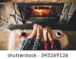 bare couple feet by the cozy... | Shutterstock . vector #345269126