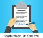 hand signing document on a...   Shutterstock .eps vector #345281498