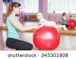 mother with happy baby doing... | Shutterstock . vector #345301808