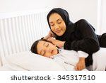 beautiful muslim mother... | Shutterstock . vector #345317510