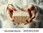 Woman's Hands Hold Christmas O...