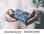 woman's hands hold christmas or ... | Shutterstock . vector #345341540