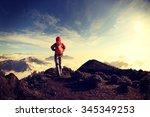 successful woman hiker hiking... | Shutterstock . vector #345349253